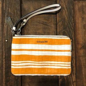 Clack embossed Bleeker wristlet orange & white